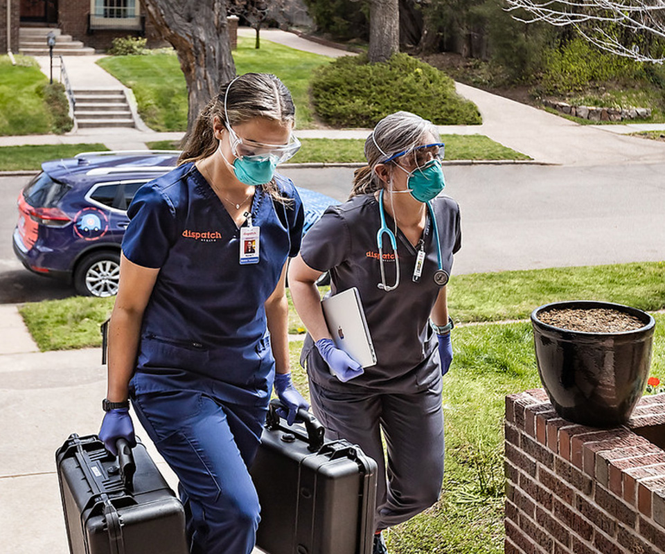 Nurses walking up to a house for a house call