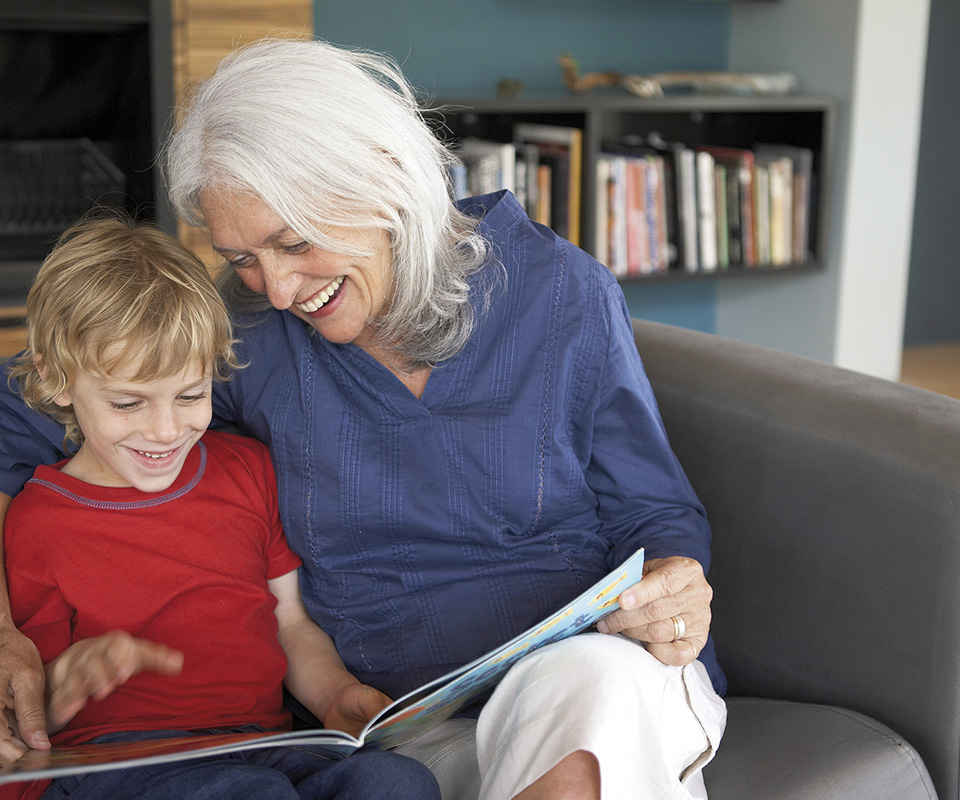 Woman reading to grandchild