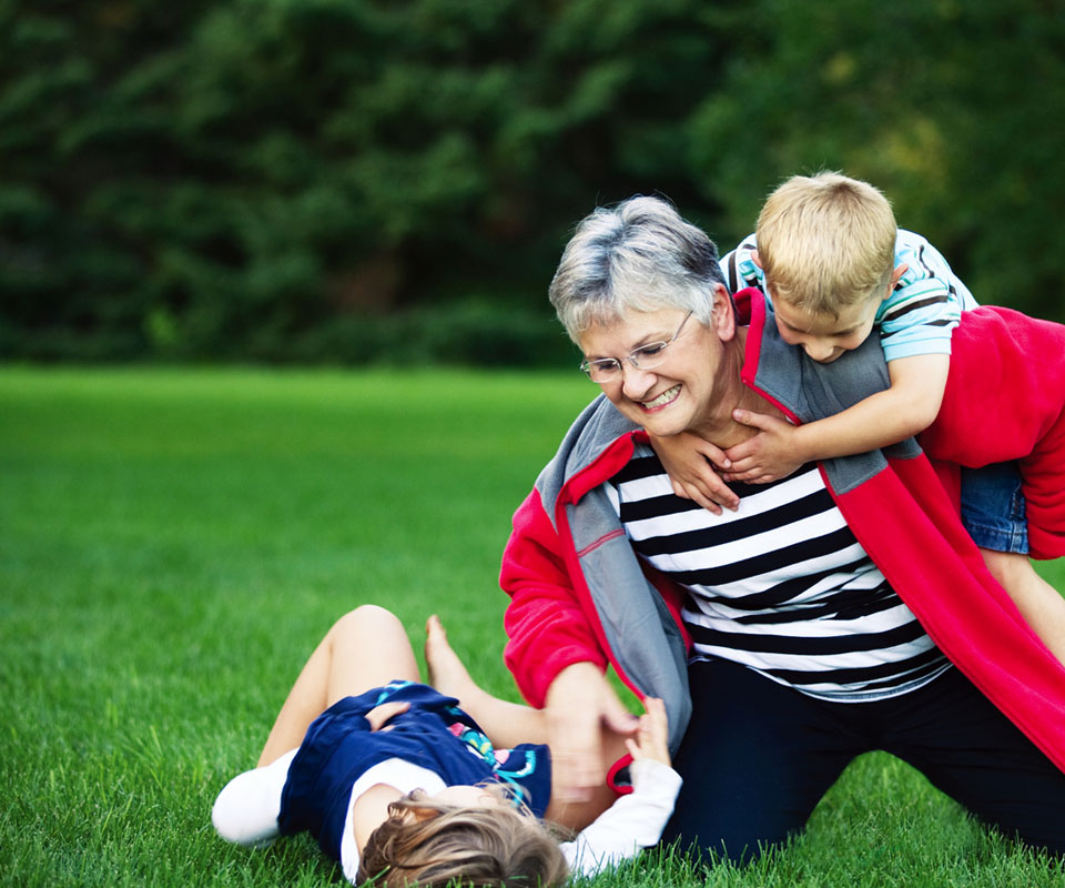 Senior woman playing with her grandkids