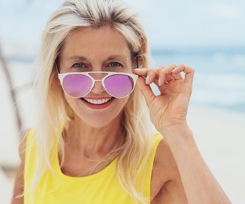 Mature woman wearing sunglasses