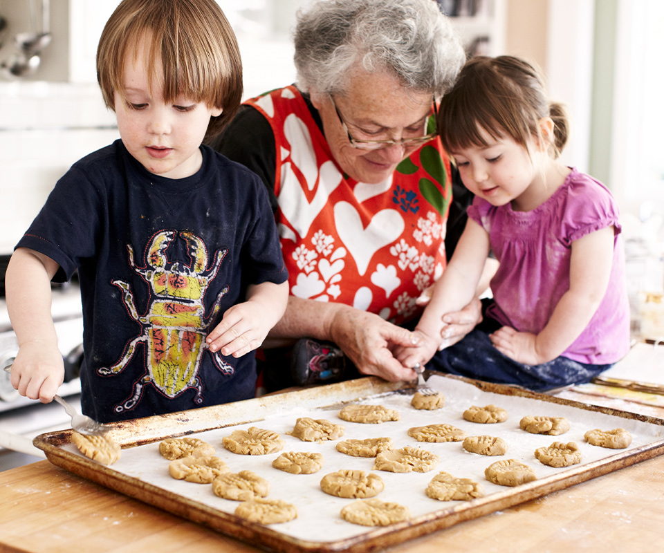 Grandma and grandchildren baking