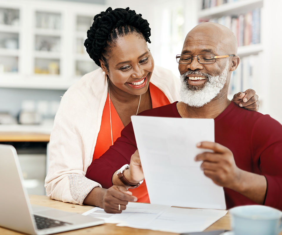 Couple looking over insurance benefits