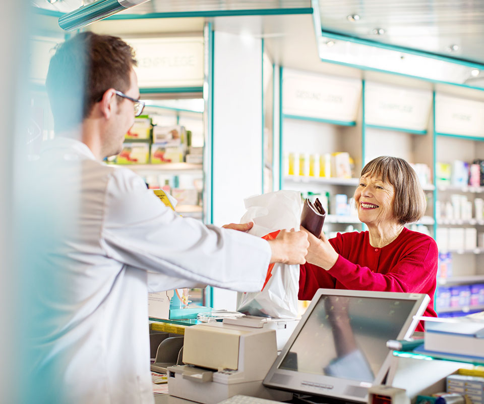 Smiling woman at pharmacy