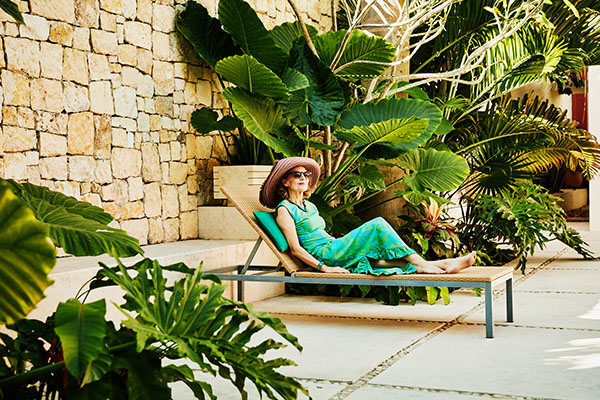 Woman on a lounge chair