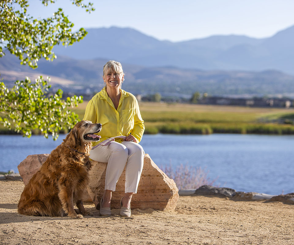 senior woman with dog at a golf course