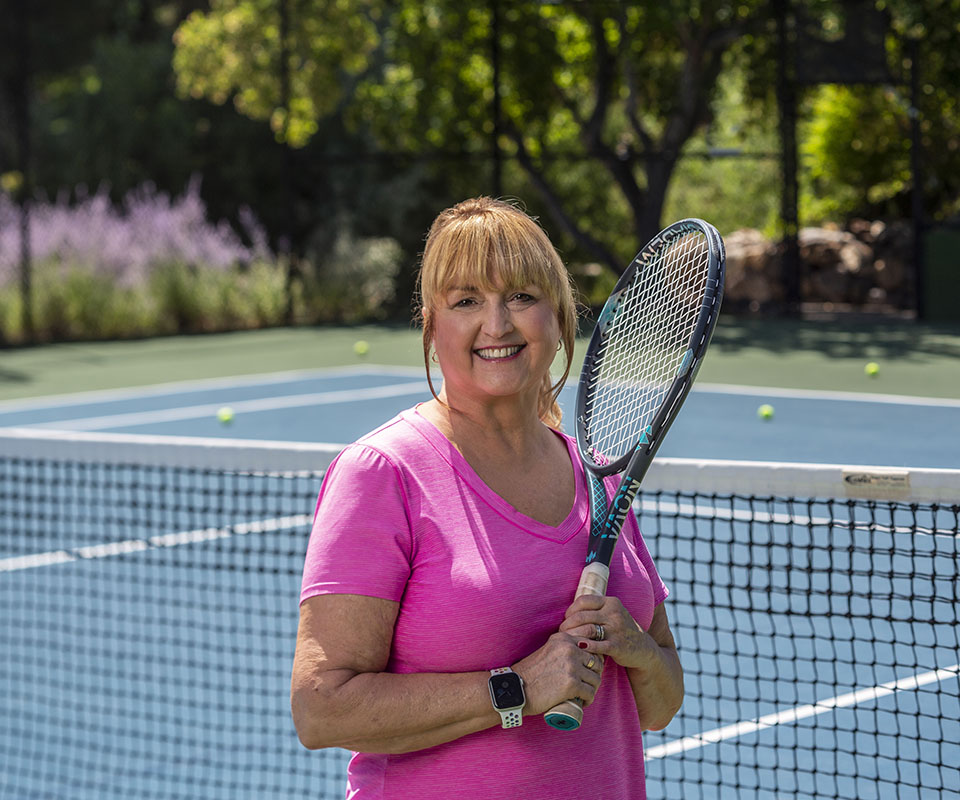 senior woman holding a tennis racket